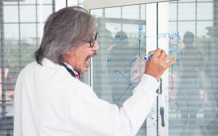 Professor doctor writing on the glass bilboard - See Far smart glasses